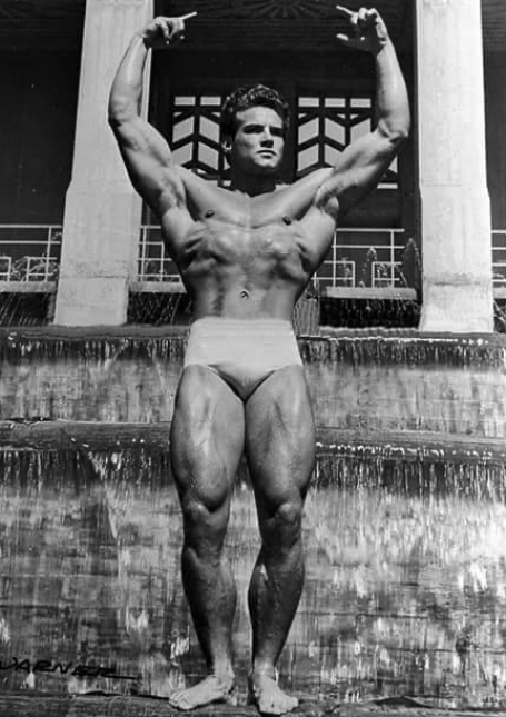 Steve Reeves Overhead Victory Bodybuilding Pose Showing Rectus Femoris Quads