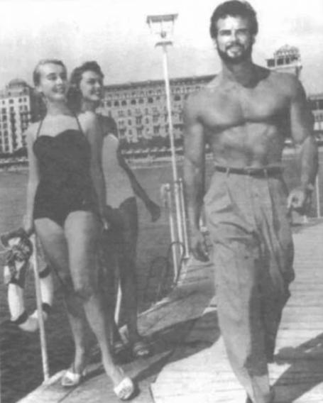 Steve Reeves Walking Outside Boardwalk